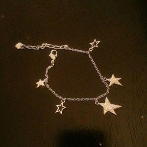 Swarovski star bracelet.